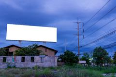 Blank billboard at twilight time ready for new advertisement - stock photo