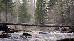 Dangerous bridge across the mountain river Stock Footage