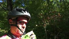 Mountain biker dress protective helmet before bike downhill race Stock Footage