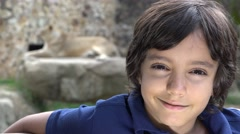 Stock Video Footage of Preteen Boy Posing at Lion Exhibit