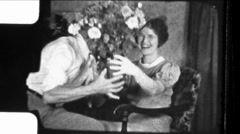 Man Gives Woman Valentine's Day Flowers KISS 1930s Vintage Film Home Movie 8586 - stock footage