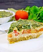 Pie celtic with spinach on board Kuvituskuvat