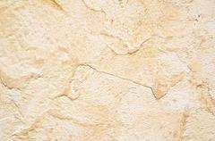 Wall with brown plaster - stock photo