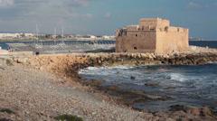 The Paphos Castle on Mediterranean seashore in Cyprus island, waves breaking Stock Footage