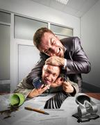 Businessmen fighting for agreement signing - stock photo