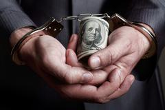 Business man arrested for bribe - stock photo