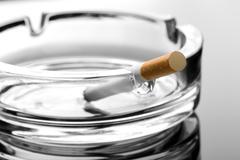Cigarette on ashtray Stock Photos