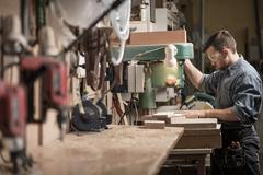 Stock Photo of Carpenter using new technology