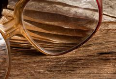 Antique glasses on old weathered book - stock photo