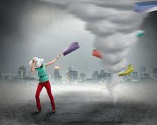 Woman and shopping tornado Kuvituskuvat