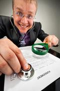 Bizarre businessman examining the agreement - stock photo