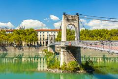 Old Passerelle du College bridge over Rhone river in Lyon, France - stock photo