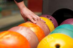 Taking bowling ball Stock Photos