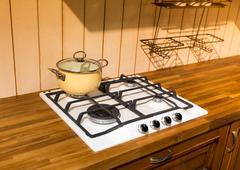 Pan on the stove Stock Photos