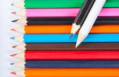 Color pencils with black and white on top - stock photo