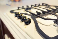 Stove on the white modern kitchen - stock photo