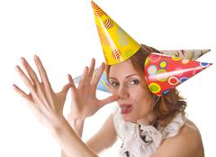 Joking woman in three party hats - stock photo