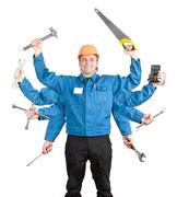 Smiling worker with tools in many hands Stock Photos
