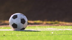 Close up of a soccer ball being kicked back into play - stock footage