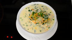 Plate with cheese soup is on  stove - stock footage