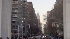 Zooming out from Empire State Building through Washington Square Park arch in 4K Stock Footage