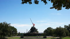 Iwo jima memorial framed by trees Stock Footage