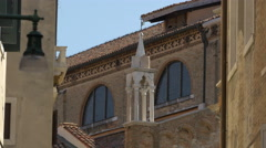 Santo Stefano church with small decorated tower and windows in Venice Stock Footage
