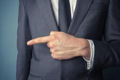 Businessman pointing left - stock photo
