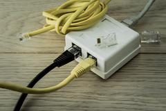 network cables and hub - stock photo