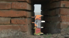 View of buildings through the Alba Iulia fortress bricks Stock Footage