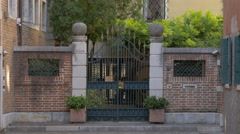 Beautiful gate with brick walls in Venice - stock footage