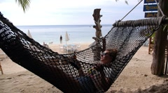 Woman Relaxing in Hammock on Tropical Beach Stock Footage