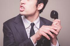 Hush, I'm on the phone! Stock Photos