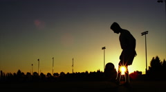 Stock Video Footage of Silhouette of a soccer player juggling a ball