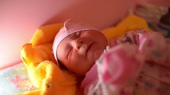 Newborn baby girl wake up hungry - cry and scream Stock Footage