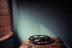 Film reel on table Stock Photos