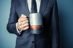 Man in suit holding a moka pot - stock photo