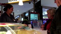 People buying lottery ticket inside shopping mall Stock Footage