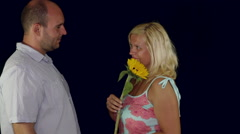 Funny couple in love with flower seducing each other Stock Footage