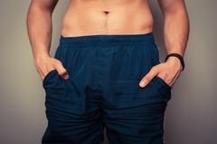 Fit young man with toned stomach - stock photo
