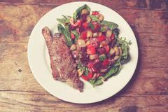Sirloin steak and salad - stock photo