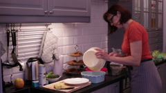A woman pours the batter in the baking form Stock Footage