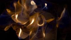 Burning 100 argentinian pesos bills Stock Footage
