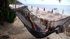 Woman in Hammock on Tropical Beach on Vacation - stock footage