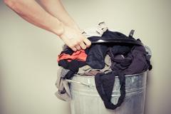 Woman sorting out her laundry - stock photo
