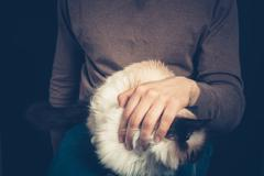 Young man with a cat on his lap - stock photo