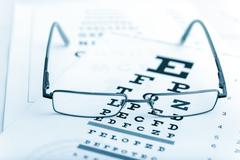 Clear Black modern glasses on a eye sight test chart Stock Photos