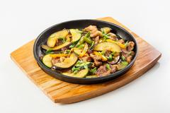 Meat and vegetables in the pan - stock photo