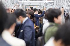 Passengers traveling by Tokyo metro. Stock Photos