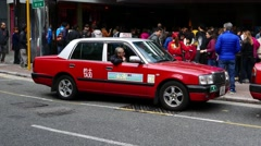 Traditional red toyota crown taxi against people queue, Hong Kong Stock Footage